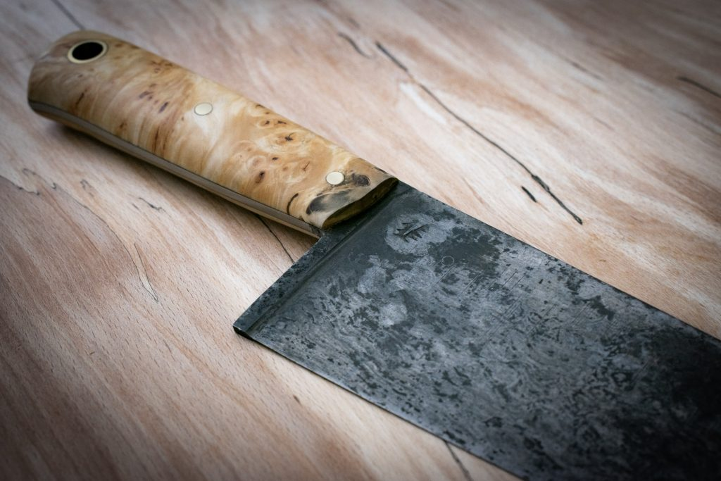 "9"" (230mm) French 'Sabatier' style chefs knife. Constructed from suspected 1950's sawmill blade with dark etched patina. The wood used in the construction of its handle came from an ancient tree taken down due to disease in the Precisely Hills in Pembrokeshire."