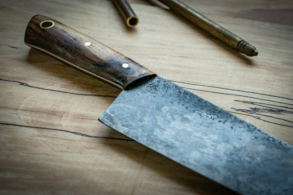 "A traditional 8"" (200mm) carbon steel chefs knife. This German 'Wusthof' style design was constructed from a 1960's sawmill blade with rare Judas tree wood and Victorian brass stair rods."